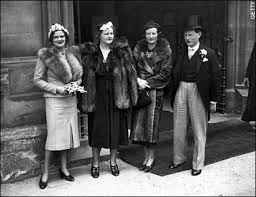 Evelyn Waugh with two Lygon sisters